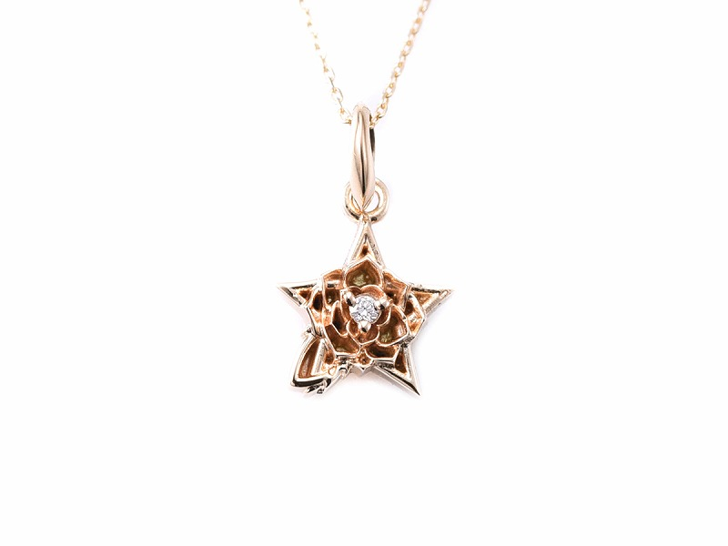 TINY STAR ROSE PENDANT